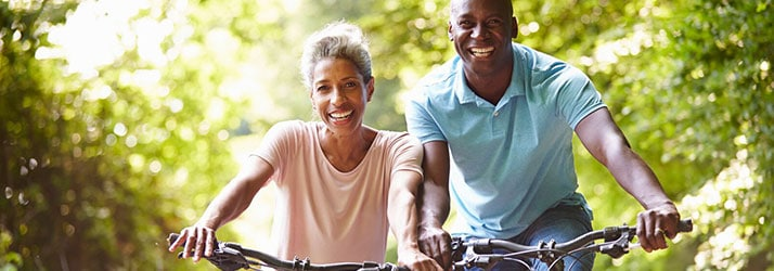 Chiropractic Cary NC Couple Biking